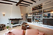 Chaise lounges in sitting room with built in bookcases