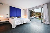 Bedroom with pocket doors to outside