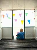 Children sitting in doorway together