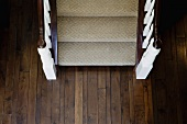 Aerial view traditional carpeted staircase and hardwood floor