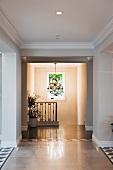 Chandelier hanging at end of hallway