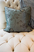 Contemporary decorative throw pillow on chair