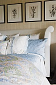 Contemporary bed with patterned pillows and blankets