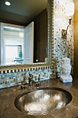 Hand pounded sink and mosaic tile wall