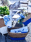 Wicker basket and hand bag, the bottom halves painted blue, for storage
