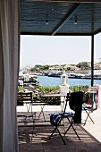 Covered terrace with a view of Canal Menorca