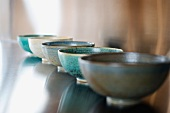Row of bowls on countertop