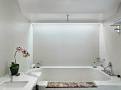 Clean modern bathroom with hot tub