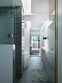View of modern bathroom through door