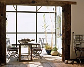 Dining table in rustic extension with glazed facade