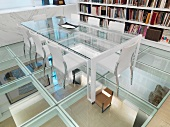 Glass conference table in room with glass floor