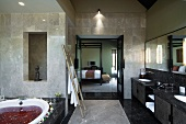 Large master bathroom with spa treatment in bathtub