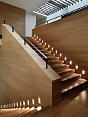 Large contemporary staircase with recessed guide lights