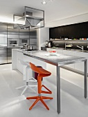 Modern Kitchen with orange and white bar stools