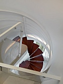 View from top down modern spiral staircase