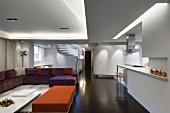 Modern interior with orange and purple furnishings