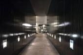 Hallway with tile floor and recessed lighting in walls
