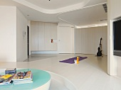 Bass guitar and yoga mat in minimalistic home