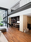Modern interior with spiral staircase and hardwood floors