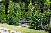 Quiet seating area amongst jasmine bushes covered in white flowers
