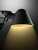 Close up of illuminated desk lamp