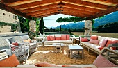 Patio with wicker furniture and pink throw pillows