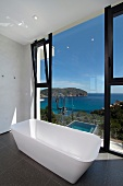 Freestanding bathtub with ocean view