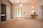 Large empty room with stone floors