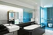 Black bathtub in modern marble bathroom