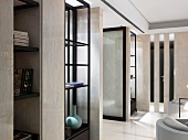 Cool interior ambiance created by pale, reflective marble surfaces and black wood fittings