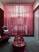 Vanity in room with red walls
