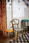 Old stool and chair with baguette as leg in dilapidated surroundings