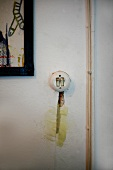 Vintage light switch and slot plastered with mashed potato next to surface-mounted cable
