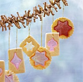 Christmas biscuits hanging from garland
