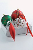 Set of Christmas baubles in open box