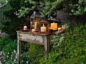 Lit candles on a Rustic Table in the Garden