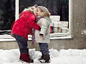 Children kissing in snow