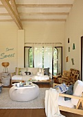 Pleasant living area with armchairs and sofa in front of terrace windows in Mediterranean house