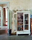 Old, glass-fronted cupboard with photographic print on back wall