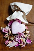 Heart lying in dried rose petals