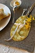 Egg shaped cutlery pouch decorated with forsythia