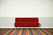 Red Couch Against Wall