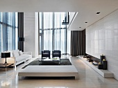 Living room with an open ceiling in elegant designer style