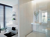 Elegant designer bathroom with a room partition between the vanity and toilet areas