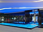 Covered entrance area with a floor made of illuminated glass panels
