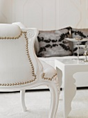 Neo-baroque chair with curved wood frame and riveted white leather upholstery