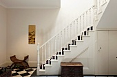 A classic stairway with turned banister and stair runner
