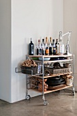 Well stocked serving trolley with champagne bottles, wine glasses and cookware