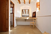 Clean bathroom with wooden ceiling beams