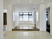Empty modern home with white accordion doors